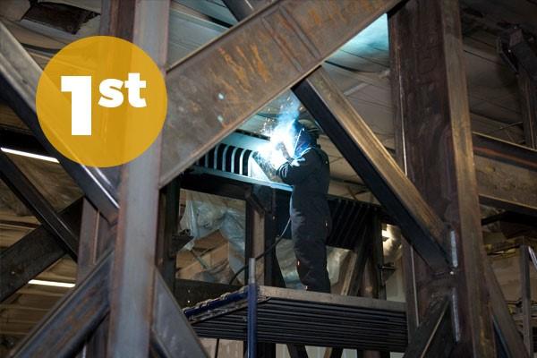 Person welding in a scaffold
